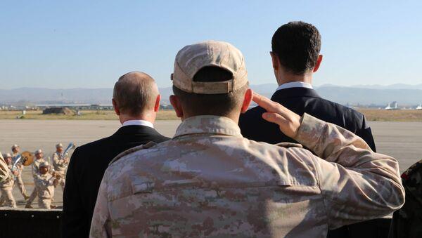Ruský prezident Vladimir Putin a syrský prezident Bašár Asad - Sputnik Česká republika