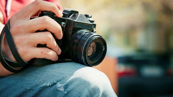 Fotograf s fotoaparátem - Sputnik Česká republika