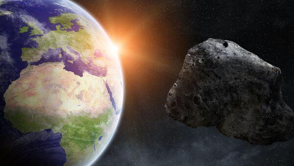 Астероид на фоне Земли - Sputnik Česká republika
