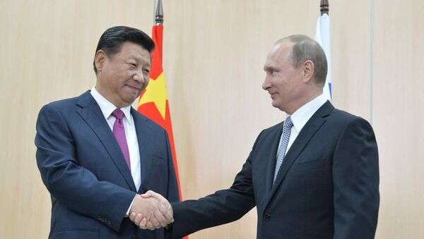 Čínský prezident Si Ťin-pching a ruský prezident Vladimir Putin - Sputnik Česká republika