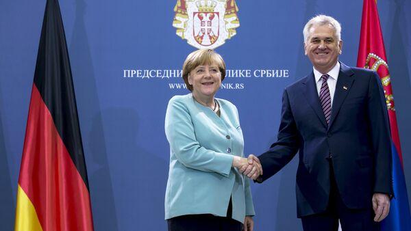 Německá kancléřka Angela Merkelová a srbský prezident Tomislav Nikolić - Sputnik Česká republika