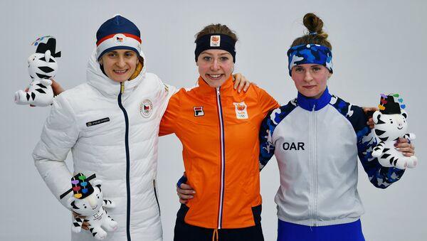 Martina Sáblíková na stupních vítězů po závodu na 5000 metrů - Sputnik Česká republika