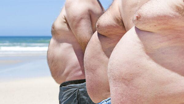Muži na pláži. Ilustrační foto - Sputnik Česká republika