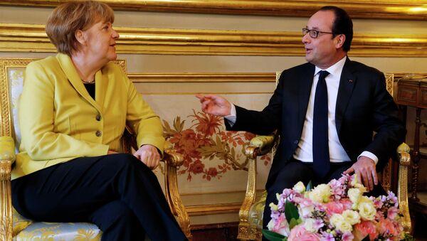 Německá kancléřka Angela Merkelová a francouzský prezident Francois Hollande - Sputnik Česká republika