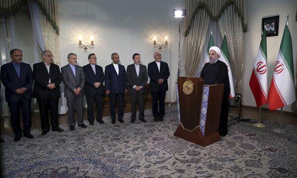 Prezident Íránu Hasan Rúhání během televizního poselství - Sputnik Česká republika