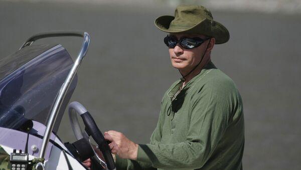 Vladimir Putin během dovolené v Republice Tuva. - Sputnik Česká republika
