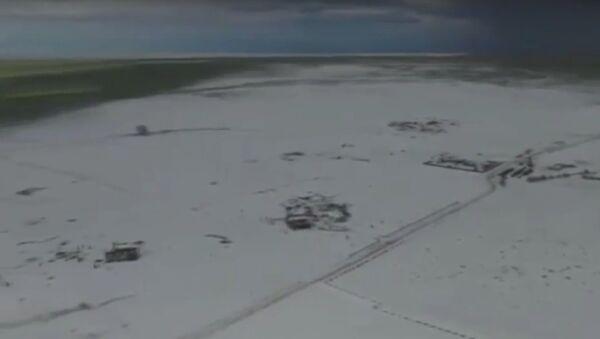 Kroupy v Coloradu vytvořily ostrov z ledu. Kolem je jaro (VIDEO) - Sputnik Česká republika