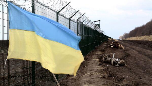 Ukrajinská vlajka na rusko-ukrajinské hranici v Charkovské oblasti - Sputnik Česká republika
