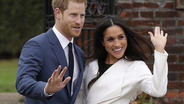 Princ Harry a jeho žena Meghan, vévodkyně ze Sussexu - Sputnik Česká republika