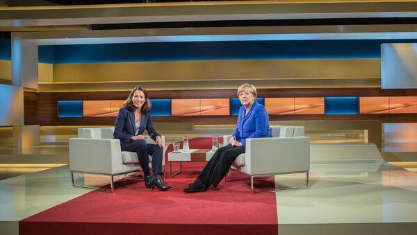 Kancléřka Angela Merkelová a moderátorka Anne Will - Sputnik Česká republika