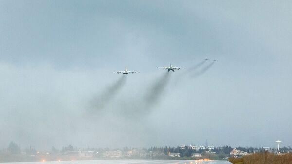 Ruské letouny nad základnou Hmímím v Sýrii - Sputnik Česká republika