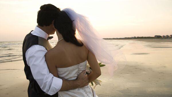 Manželé na pláži. Ilustrační foto - Sputnik Česká republika
