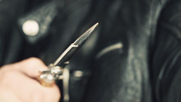 Muž s nožem v ruce - Sputnik Česká republika