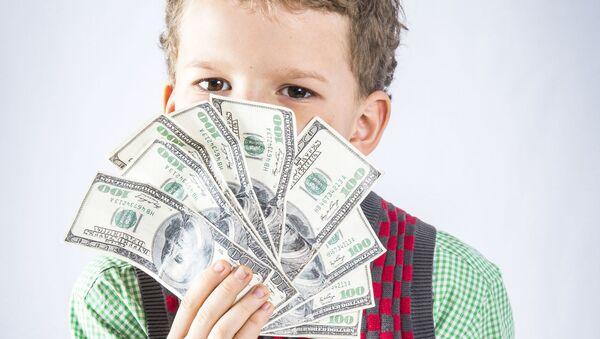 Chlapec s dolary - Sputnik Česká republika