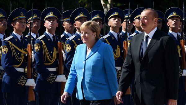 Angela Merkelová a зrezident Ázerbájdžánu Ilham Alijev. - Sputnik Česká republika