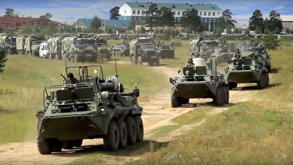 Ruské obrněné transportéry během vojenského cvičení (ilustrační foto) - Sputnik Česká republika