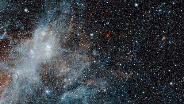 Один из самых больших остатков сверхновой звезды в Млечном пути под названием HBH 3, сфотографированный телескопом NASA Spitzer - Sputnik Česká republika