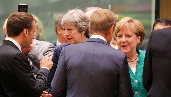 Britská premiérka Theresa Mayová a německá kancléřka Angela Merkelová na neformálním summitu EU - Sputnik Česká republika