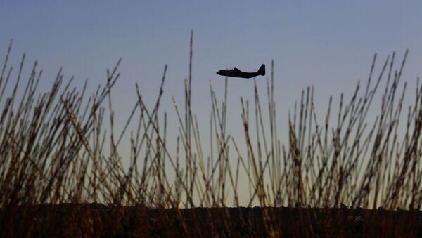 Vojenské letadlo nad Kyprem. Ilustrační foto - Sputnik Česká republika