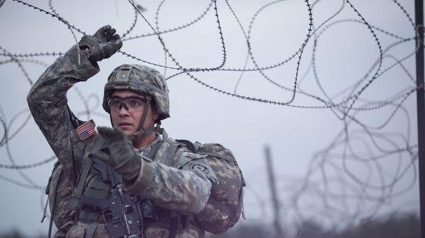 Americký voják během cvičení NATO v Evropě. Ilustrační foto - Sputnik Česká republika