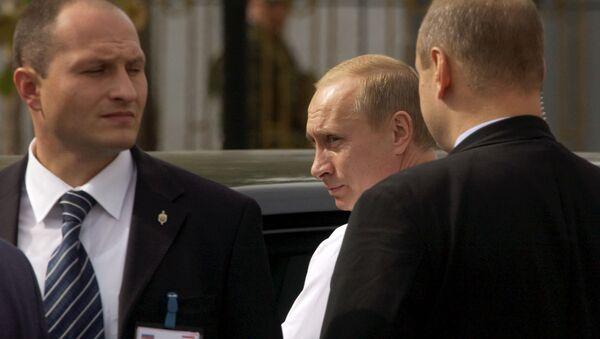 Ruský prezident Vladimir Putin a jeho ochranka - Sputnik Česká republika