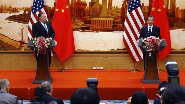 Americký ministr zahraničí Mike Pompeo a čínský ministr zahraničí Wang L - Sputnik Česká republika