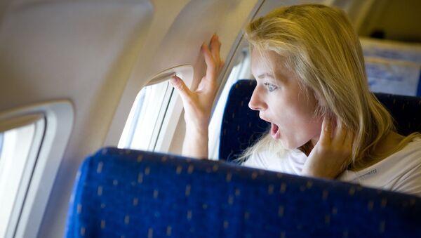 Žena v letadle - Sputnik Česká republika