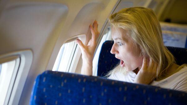 Překvapená dívka v letadle - Sputnik Česká republika