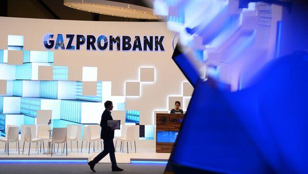 Stánek ruské banky Gazprombank na mezinárodním fóru v Petrohradě - Sputnik Česká republika