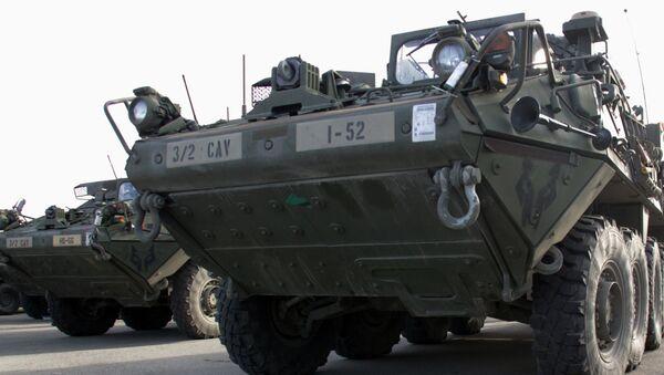 Americké obrněné transportéry Stryker v Rize - Sputnik Česká republika