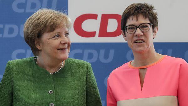 Angela Merkelová a Annegret Kramp-Karrenbauerová - Sputnik Česká republika