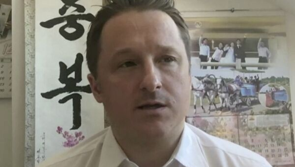 In this image made from video taken on March 2, 2017, Michael Spavor, director of Paektu Cultural Exchange, talks during a Skype interview in Yangi, China - Sputnik Česká republika