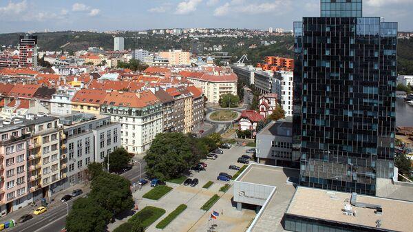 Pohled na budovu NKÚ a část Holešovic z vrcholu Lighthouse Vltava Waterfront Towers v pražských Holešovicích. - Sputnik Česká republika