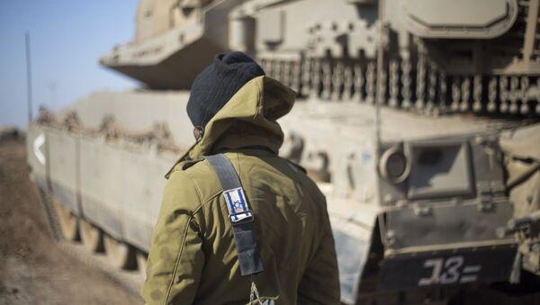 Izraelský voják na hranici se Sýrií - Sputnik Česká republika