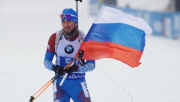 Alexandr Loginov při dojezdu vítězné štafety v německém Oberhorfu - Sputnik Česká republika