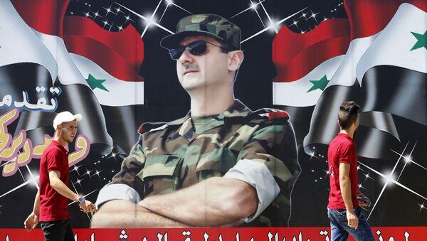 Plakát syrského prezidenta Bašára Asada v Damašku - Sputnik Česká republika