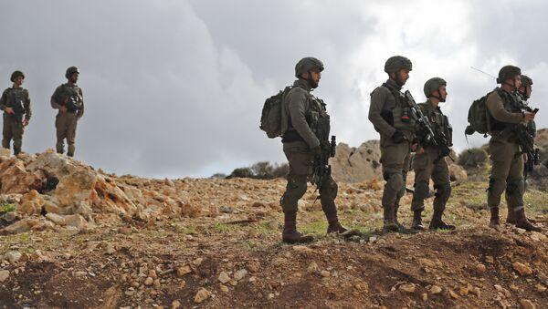 Izraelští vojáci na hranici Izraele a Pásma Gazy - Sputnik Česká republika