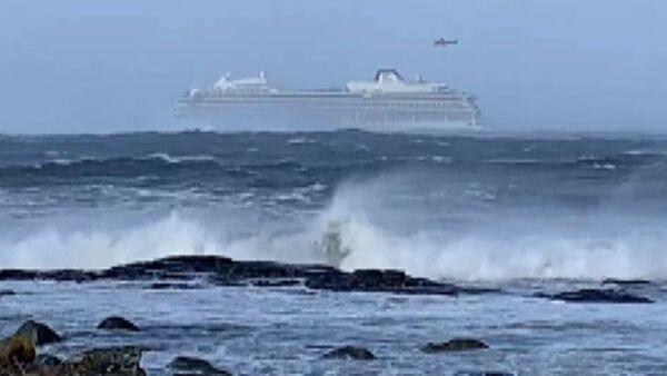Havárie lodě poblíž Norska. Jak vypadala katastrofa očima pasažérů - Sputnik Česká republika