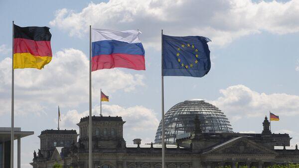 Vlajky SRN, Ruska a EU - Sputnik Česká republika