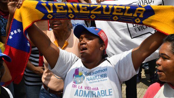 Akce na podporu venezuelské vlády v Caracasu - Sputnik Česká republika