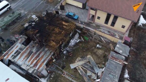 Zbytky budovy. V Rusku dron zachytil následky operace proti IS na Sibiři - Sputnik Česká republika