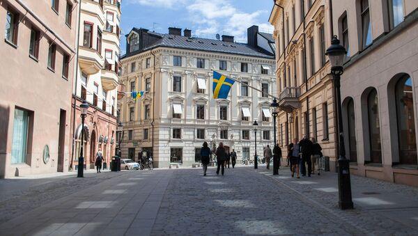 Švédské vlajky ve Stockholmu - Sputnik Česká republika