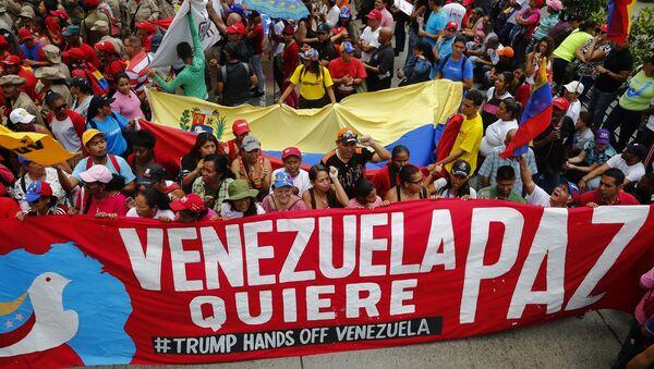 Akce na podporu venezuelského prezidenta Nicoláse Madura v Caracasu - Sputnik Česká republika