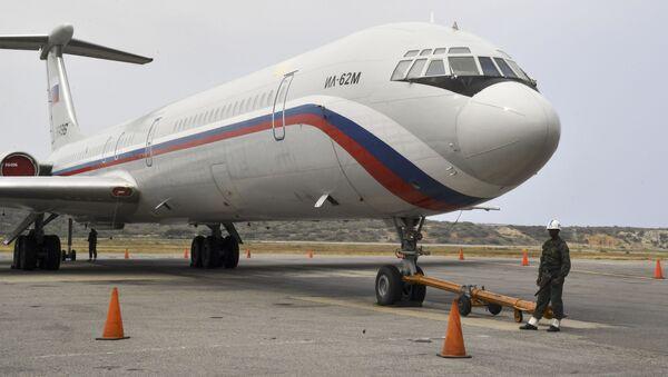 Ruské letadlo Il-62M na letišti Simon Bolivar ve Venezuele - Sputnik Česká republika